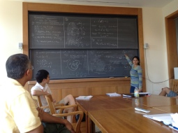 Sudha Rao, an advanced student, lectures to the intermediate and advanced groups.
